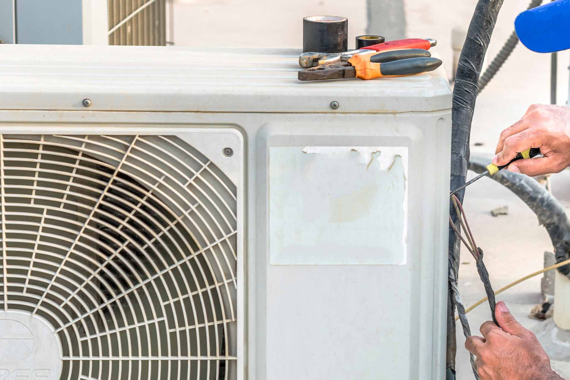 AC repairs being performed on an air conditioning unit near Winter Haven, FL.