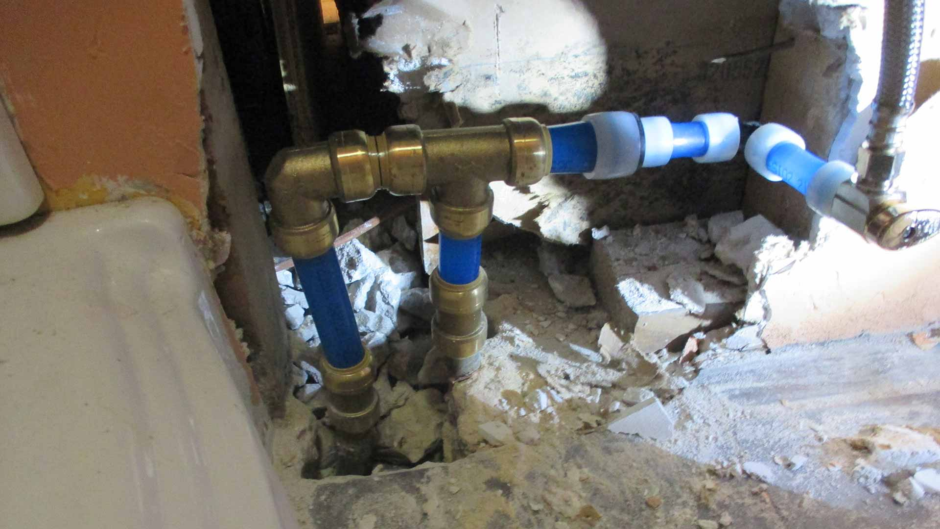 True Plumbers performing a repiping job in Wesley Chapel, FL.