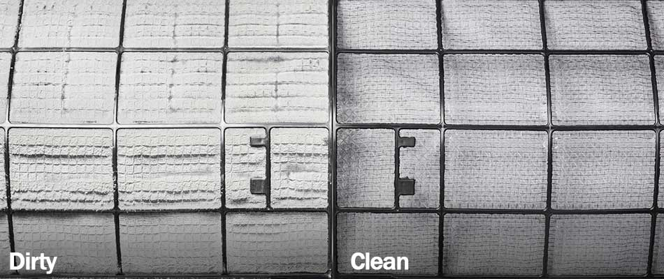 Photo showing differences between dirty and clean air conditioning filters at a home in Plant City, FL.