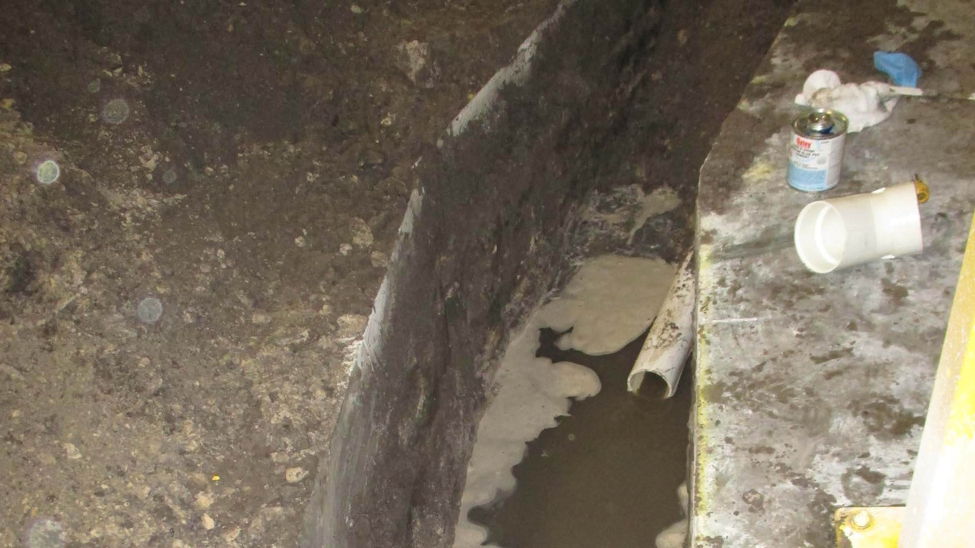 Flooded slab leak in Plant City being repaired by True Plumbers.